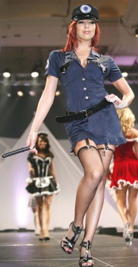 Coquette: Sexy cop.