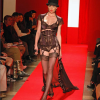 Stephanie Arrue: Aubergine and black bra, panty and black corset with black, ruffle-trimmed robe.