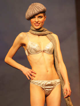 Mimmelu: Tanga and bra with metallic pattern.