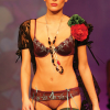 Incanto: Purple string and bra with turquoise details and matching suspender belt.