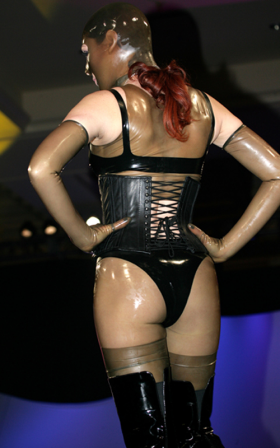 Fetisso: Latex Gleason-transparent latex top, shorts, stockings, long transparent gloves and open mask.