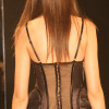 Black bustier and panty with long sheer bustle skirt (rear view).