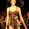Black lace bodysuit & taupe corset with boudoir skirt (front view).