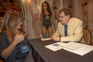 Rodrigo Cano speaking with a customer at a trade show.