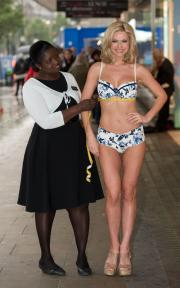 A model gets fitted outside of a Debenhams store.