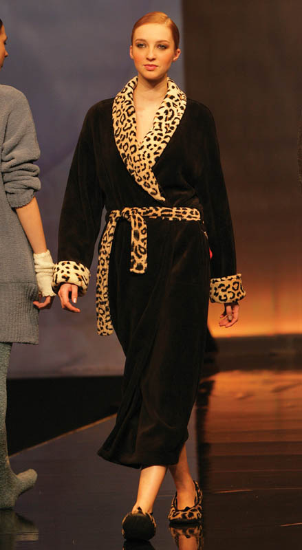 Taubert: Leopard trim black dressing gown with matching slippers.