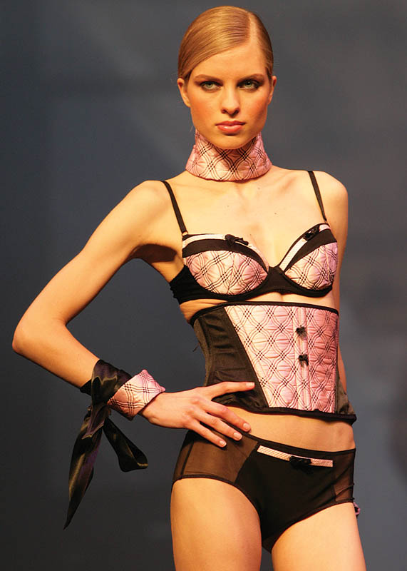 Der Kommissar: Black and pink garter belt, panty and bra with choker and handcuffs.