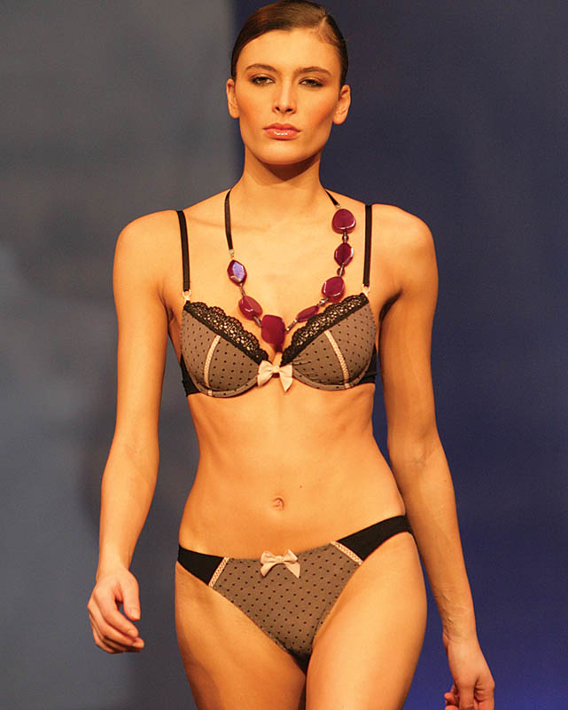 Hechter: Black and pink polka dotted brief and bra.