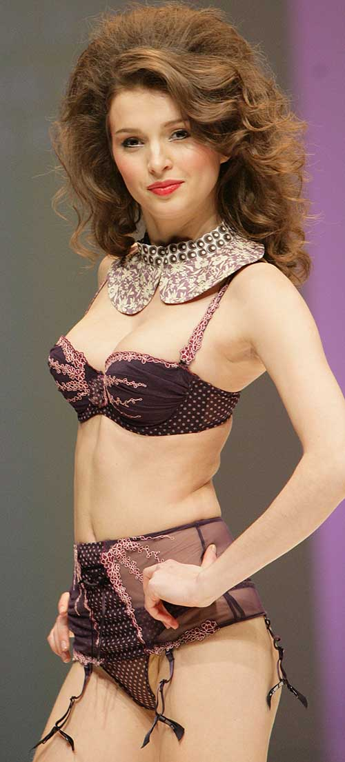 Wacoal: Brown and pink polka dot bra and suspender brief.
