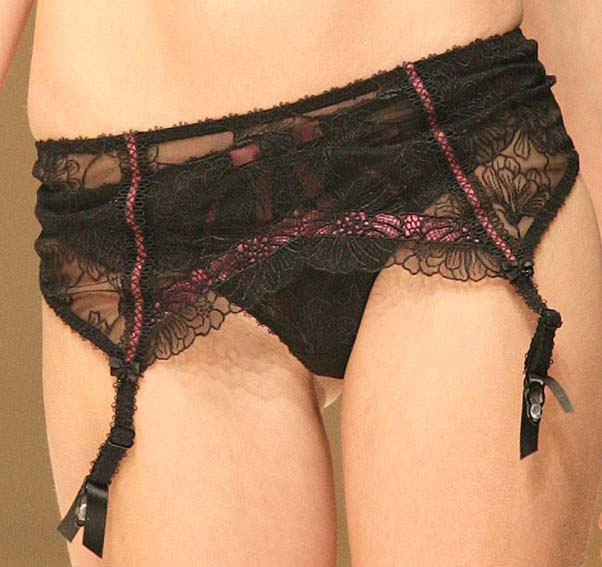 Fauve: Black and prune string and garter belt.
