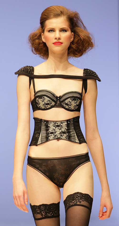 Gracija Rim: Black and white bra, brief and waist belt.