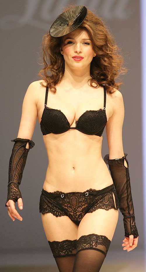 Luna: Black bra, tanga and sleeves.