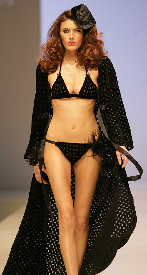 Harlett Luxury Lingerie: Black basque with feathers and bra and panty set.