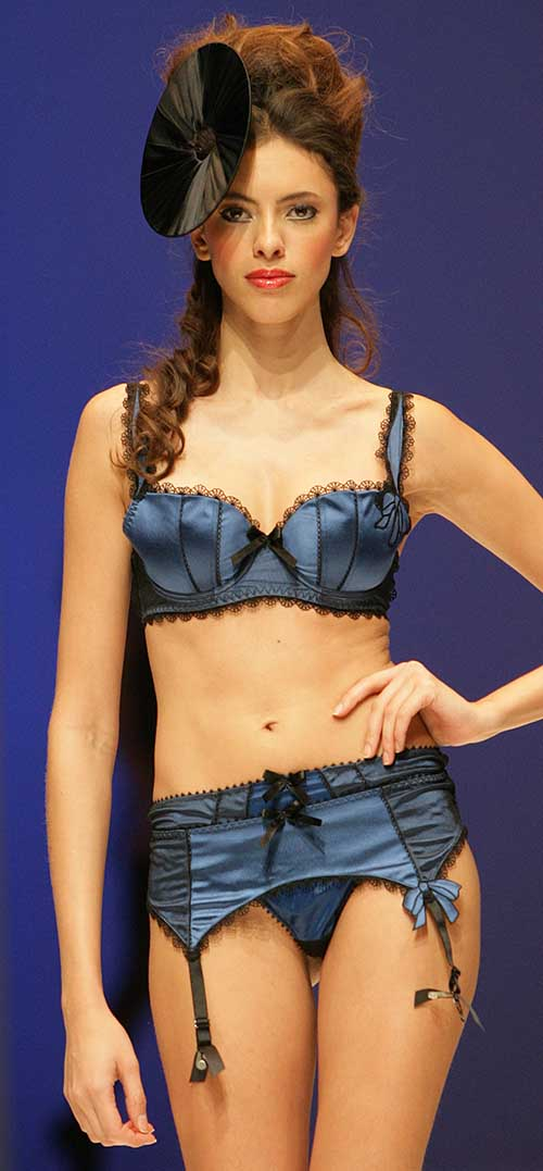 Fauve: Black and blue bra, string and suspenders.