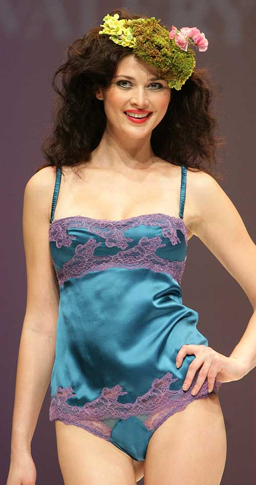 Valery Prestige: Turquoise and purple top and string.